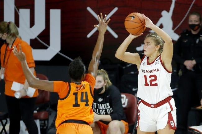 Oklahoma's Gabby Gregory (12) shoots over Oklahoma State's Taylen Collins (14) on Tuesday. [Bryan Terry/The Oklahoman]