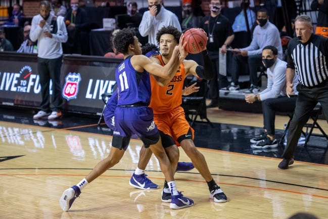 OSU guard Cade Cunningham, right, looks to shoot the ball with seconds left while defended by TCU guard Taryn Todd on Wednesday. [Rob Ferguson/USA TODAY Sports]