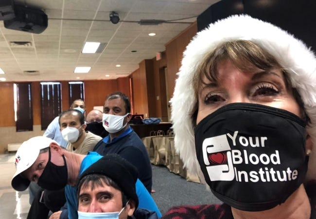 Mary Blankenship Pointer and volunteers work Saturday to prepare for this year's pandemic-adapted Red Andrews Christmas Dinner. [Photo Provided]