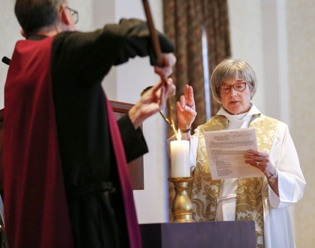 Canon Susan Colley Joplin shares a blessing at St. Paul's Episcopal Cathedral as verger Jeff Erwin lights a candle during the Memorial Requiem service for those who died while homeless in 2018. A similar memorial service will not be held this year because of the pandemic. [The Oklahoman Archives]