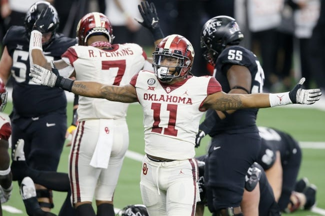Oklahoma's Nik Bonitto (11) celebrates after a sack against Iowa State in a 27-21 win for the Big 12 championship on Dec. 19 at AT&T Stadium in Arlington, Texas. [Bryan Terry/The Oklahoman]