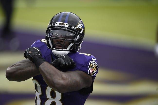 Baltimore Ravens wide receiver Dez Bryant celebrates after catching a touchdown pass against the Jacksonville Jaguars on Sunday. [AP Photo/Gail Burton]