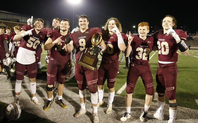 Cashion seniors pose with the Class A state title trophy after beating Thomas on Saturday at the University of Central Oklahoma's Wantland Stadium in Edmond. [Alonzo J. Adams/For The Oklahoman]