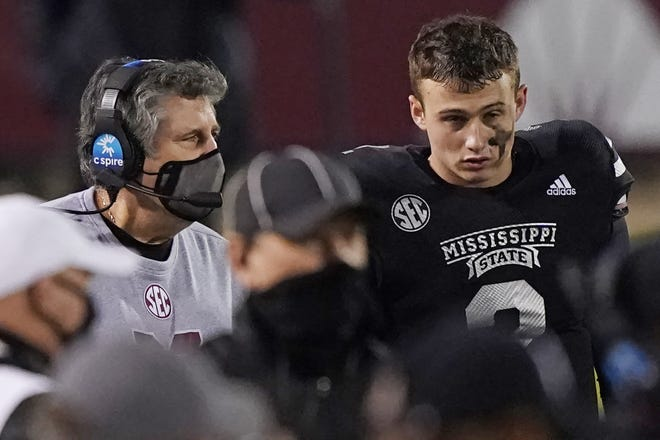 Mississippi State head coach Mike Leach, left, speaks with quarterback Will Rogers (2) in the second half of a 51-32 win over Missouri on Saturday. [AP Photo/Rogelio V. Solis]