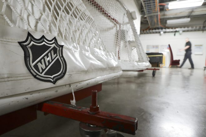 Goals used by the NHL hockey club Nashville Predators are stored in a hallway in Bridgestone Arena. The National Hockey League and players reached a tentative deal to hold a 56-game season in 2021. [AP Photo/Mark Humphrey, File]