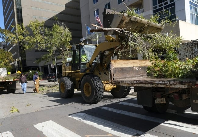Crews from the City of Oklahoma City clear away broken limbs on Broadway Ave. at Sheridan on Oct. 30 after an ice storm swept through the state. [DOUG HOKE/THE OKLAHOMAN]