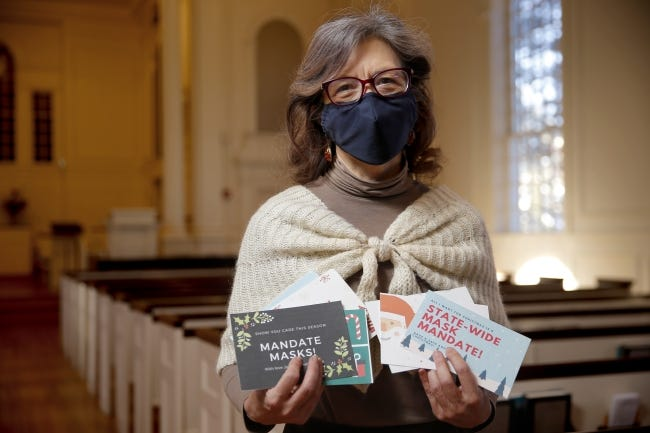 """The Rev. Diana Davies, senior minister of First Unitarian Church of Oklahoma City, holds up """"Cards Against COVID"""" at the church, 600 NW 13. [Bryan Terry/The Oklahoman]"""
