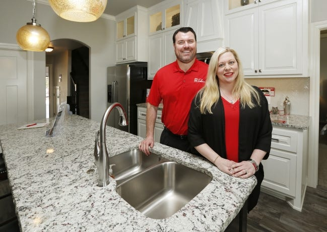 Taber and Julie LeBlanc stand in a model home by Homes by Taber. [THE OKLAHOMAN ARCHIVES]
