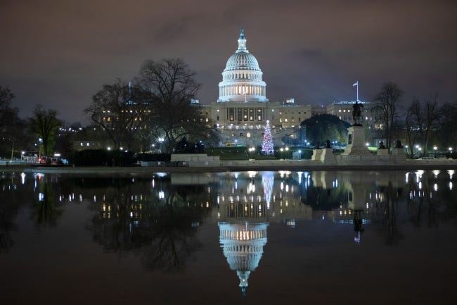 The U.S. Capitol is seen at night after negotiators sealed a deal for COVID relief. [AP Photo]