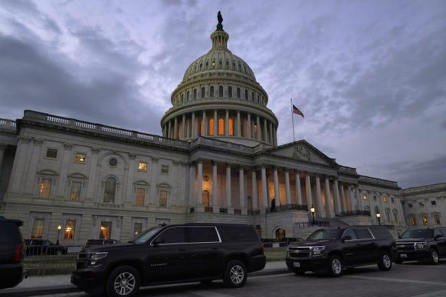Dusk falls over the Capitol, Monday, Dec. 21, 2020, in Washington. [AP Photo/Jacquelyn Martin]