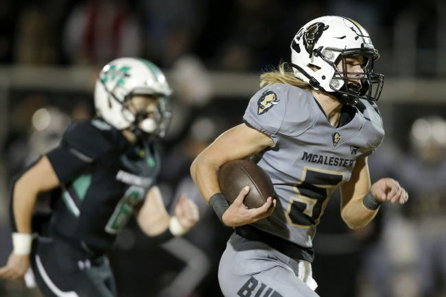 McAlester's Erik McCarty runs for a touchdown during a high school football playoff game against Bishop McGuinness on Dec. 4. [Bryan Terry/The Oklahoman]