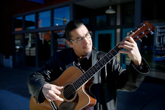 Edgar Cruz plays at the Automobile Alley streetcar stop in Oklahoma City, Saturday, Dec. 15, 2018. He will be among the performers for the virtual Opening Night 2021 New Year's Eve celebration. [Sarah Phipps/ The Oklahoman Archives]