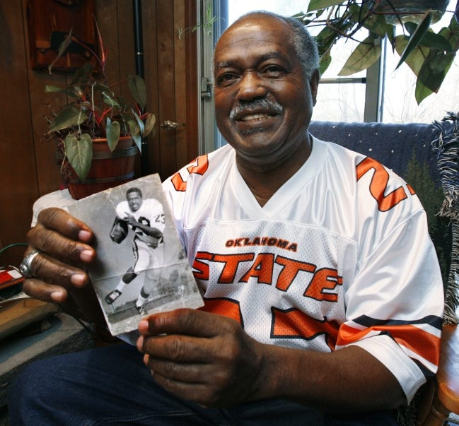 Chester Pittman is shown at his home on Friday, Nov. 6, 2009, in Kansas City, Kansas. He became the first Black man to earn a football letter exactly 50 years ago this season. The photograph in his hands is a college publicity photograph from his days at Oklahoma State University. [Steve Sisney/The Oklahoman]