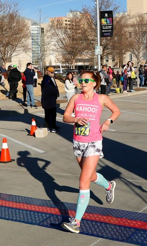Andrea McKinney, of Norman, crosses the finish line for Opening Night's inaugural Finale 5K run downtown, Tuesday, December 31, 2019. [Doug Hoke/The Oklahoman Archives]