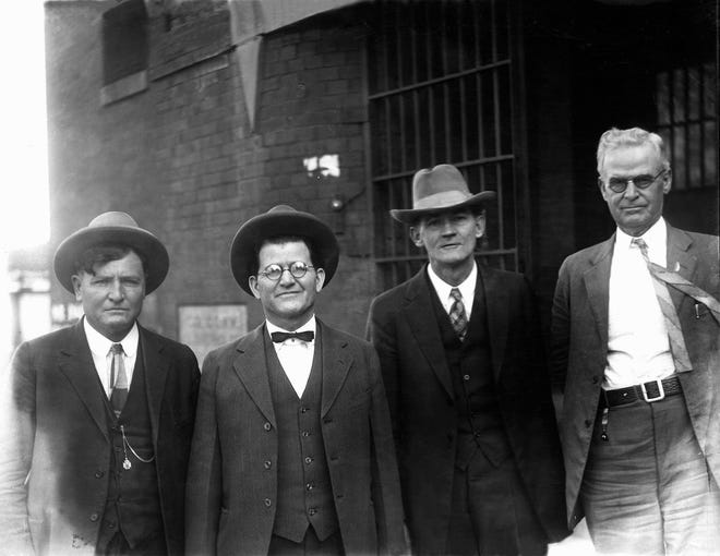 Osage murder suspects William K. Hale (second from left) and John Ransey (second from right) with U. S. Deputy Marshals James A. Stout (left) and J. A. Clouse (right) pose for a photo in 1926. The murder suspects were tried together in Guthrie during August 1926 (which resulted in a hung jury) and again in Oklahoma City during October 1926 (when both were found guilty and sentenced to life in prison) for the Jan. 26, 1923 murder of Osage tribal member Henry Roan near Fairfax. The convicted pair was transported to Leavenworth, Kansas, on Nov. 17, 1926, following their murder convictions Oct. 29, 1926 in Oklahoma City. [The Oklahoman Archives]