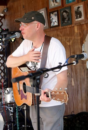 Jared Tyler performs during the Woody Guthrie Folk Festival in Okemah, Okla., Thursday, July 12, 2018. [Bryan Terry/The Oklahoman Archives]