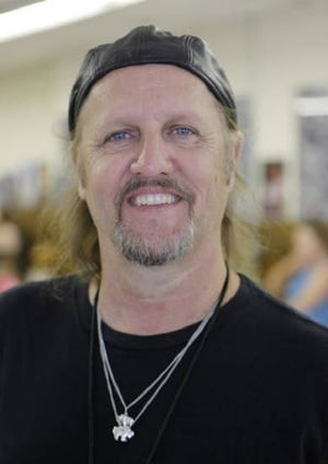 Jimmy LaFave smiles during the 2012 Woody Guthrie Folk Festival in Okemah. The red dirt music pioneer, who grew up in Stillwater and became an Austin, Texas, music icon, died May 21, 2017, of a rare, aggressive form of terminal cancer. He was 61. [The Oklahoman Archives photo]
