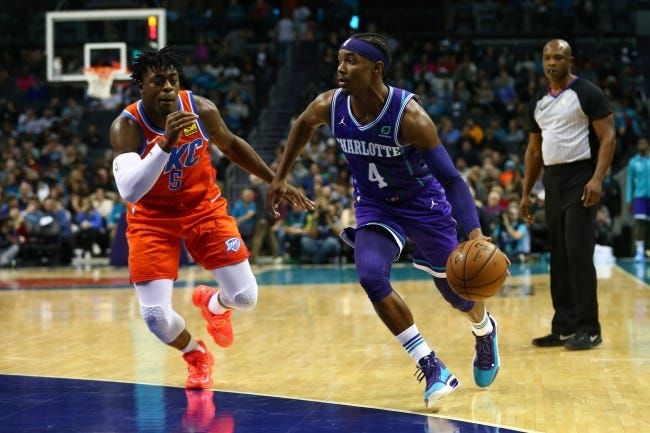 Hornets guard Devonte' Graham (4) drives the ball against Thunder guard Luguentz Dort (5) during the second half in Charlotte, N.C., on Dec. 27, 2019. [Jeremy Brevard/USA TODAY Sports]