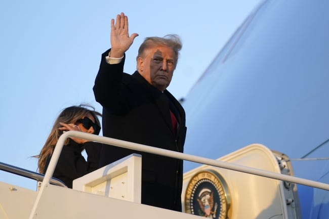 President Donald Trump waves Wednesday as he boards Air Force One at Andrews Air Force Base, Md. Trump was traveling to his Mar-a-Lago resort in Palm Beach, Fla. [AP Photo/Patrick Semansky]