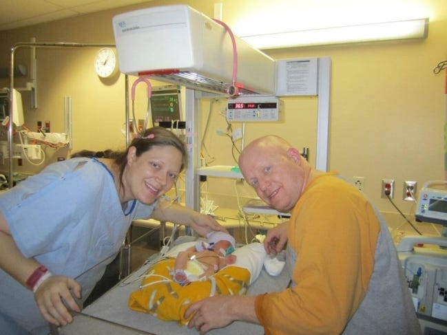 Eilene and Jason Franks meet their son, Hudson, for the first time on Christmas Day 2011. [PHOTO PROVIDED]