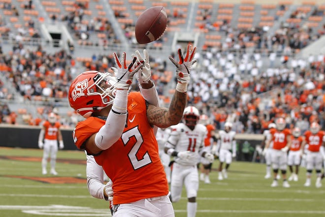 Oklahoma State receiver Tylan Wallace (2) catches a touchdown pass in a 50-44 win over Texas Tech on Nov. 28 in Stillwater. [Bryan Terry/The Oklahoman]