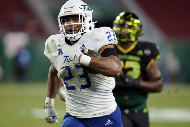 Tulsa linebacker Zaven Collins (23) runs back an interception for a touchdown at South Florida on Oct. 23. [AP Photo/Chris O'Meara]