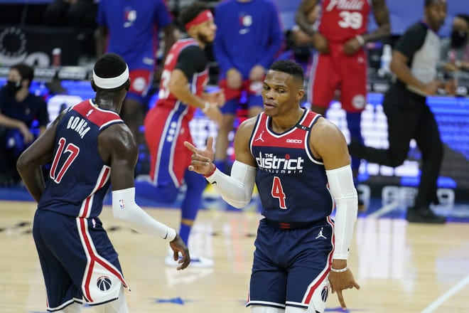 Wizards guard Russell Westbrook (4) celebrates after a basket during the second half of a 113-107 loss to the 76ers on Wednesday in Philadelphia. [AP Photo/Matt Slocum]