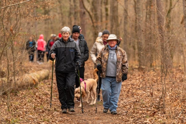 """Hikers enjoy a past """"First Day Hike"""" at Beavers Bend State Park in southeastern Oklahoma. Twenty-two state parks will be holding free, guided """"First Day Hikes"""" on New Years Day. [OKLAHOMA STATE PARKS]"""