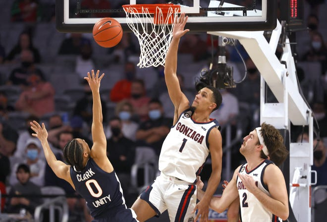 Virginia guard Kihei Clark (0) shoots as Gonzaga guard Jalen Suggs (1) and forward Drew Timme (2) defend during the second half of a 98-75 Gonzaga win Saturday in Fort Worth, Texas. Gonzaga won 98-75. [AP Photo/Ron Jenkins]