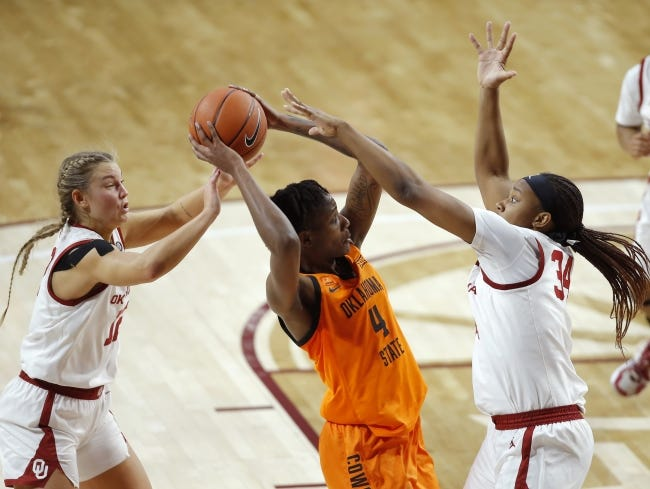 Oklahoma's Gabby Gregory (12) and Liz Scott (34) defend Oklahoma State's Natasha Mack (4) during a Bedlam game on Dec. 15 in Norman. [Bryan Terry/The Oklahoman]