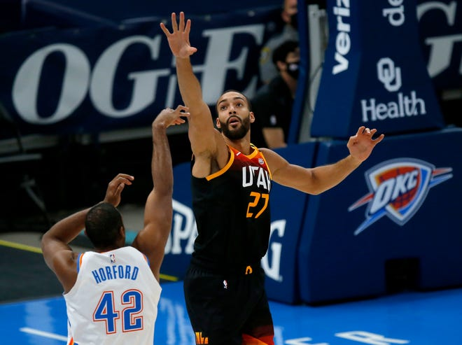 Utah's Rudy Gobert (27) defends against Oklahoma City's Al Horford (42) during the NBA game between the Oklahoma City Thunder and Utah Jazz at the Chesapeake Energy Arena in Oklahoma City, Monday, Dec. 28, 2020. [Sarah Phipps/The Oklahoman]