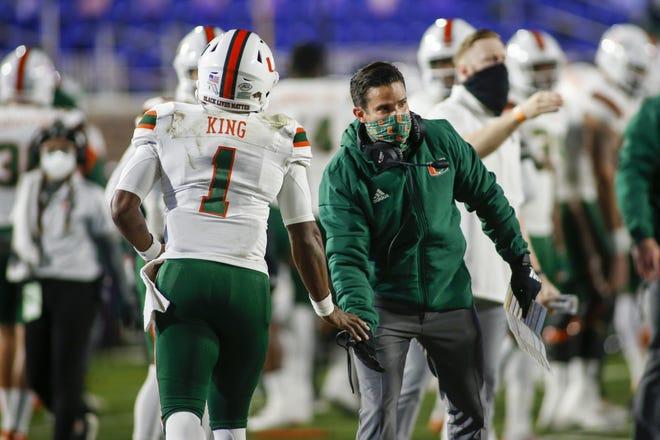 Miami coach Manny Diaz congratulates quarterback D'Eriq King (1) after a touchdown pass against Duke on Dec. 5 in Durham, N.C. [Nell Redmond/Pool Photo via AP]
