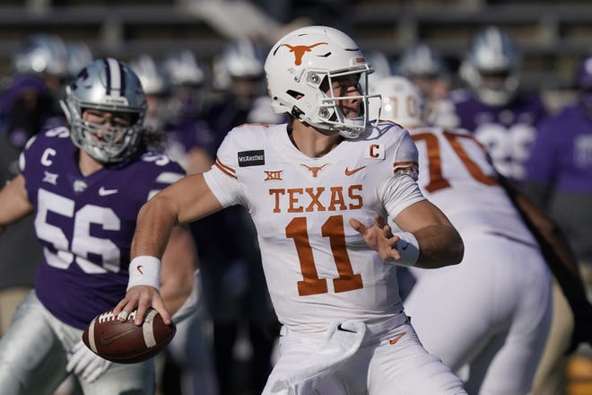 Texas quarterback Sam Ehlinger (11) passes to a teammate during the first half against Kansas State in Manhattan, Kan. [AP Photo/Orlin Wagner]