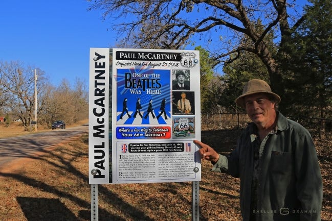 Toby Thompson, who met Paul McCartney, was invited to show Oklahoma County workers where to place the sign. [PHOTO PROVIDED]