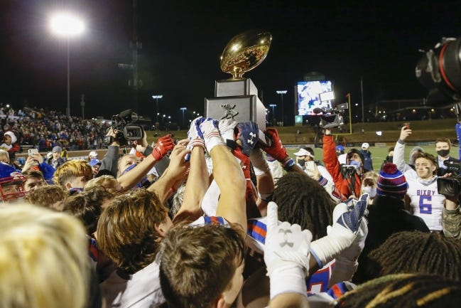 Bixby holds up the championship trophy after defeating Choctaw for the Class 6A-II football title on Dec. 5 at Wantland Stadium in Edmond. [Alonzo J. Adams/for The Oklahoman]