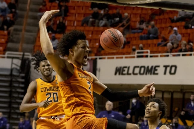 Oklahoma State guard Cade Cunningham (2) celebrates with Keylan Boone (20) after a slam dunk against TCU on Dec. 16 in Stillwater. [AP Photo/Mitch Alcala]