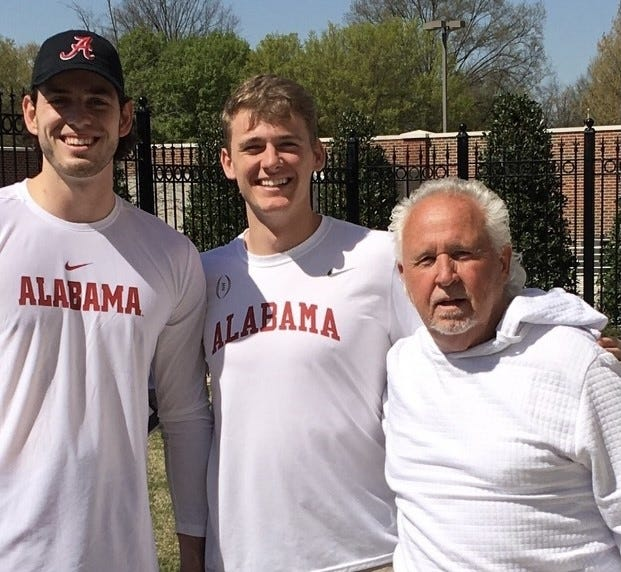 Quarterbacks coach Joe Dickinson, right, poses with Alabama quarterback Mac Jones, middle, and David Cornwell in May. Jones has been coached since he was young by Dickinson. [Photo provided]