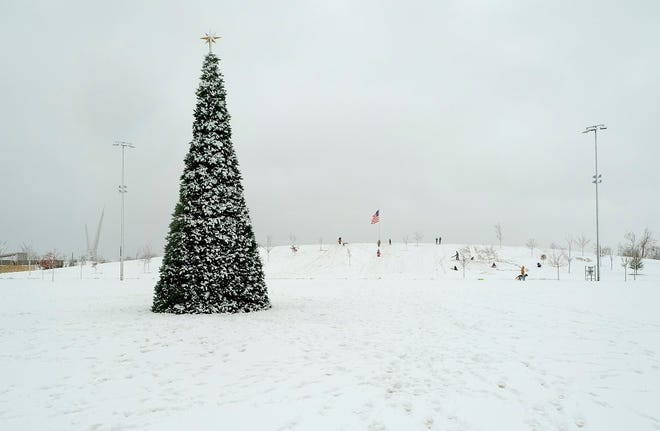 The Christmas Tree on the Love's Travel Stop Great Lawn in Scissortail Park is surrounded by snow Sunday, December 13, 2020. [Doug Hoke/The Oklahoman Archives]