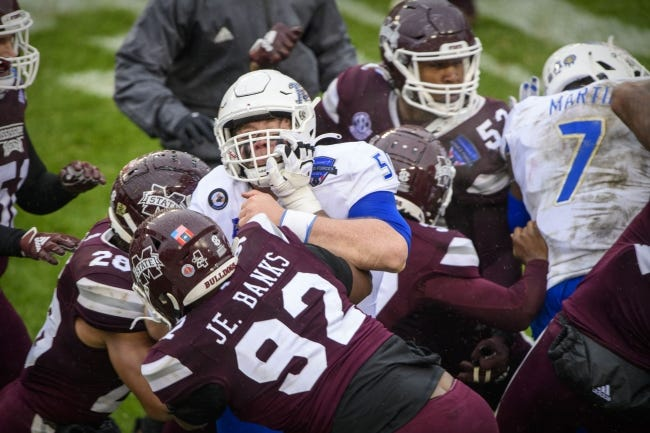 Mississippi State and Tulsa players fight after Thursday's Armed Forces Bowl at Amon G. Carter Stadium in Fort Worth, Texas. The Bulldogs won the game 28-26. [Jerome Miron/USA TODAY Sports]