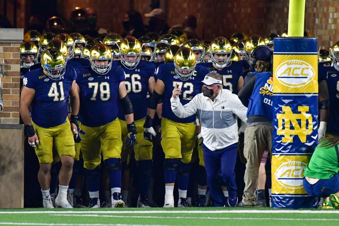 Notre Dame coach Brian Kelly leads his team out of the tunnel before a 47-40 double overtime win against Clemson on Nov. 7 in South Bend, Ind. [Matt Cashore/USA TODAY Sports]