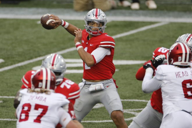 Ohio State quarterback Justin Fields repeated as offensive player of the year and is joined by three of his teammates on the Associated Press All-Big Ten football team. [AP Photo/Jay LaPrete, File]