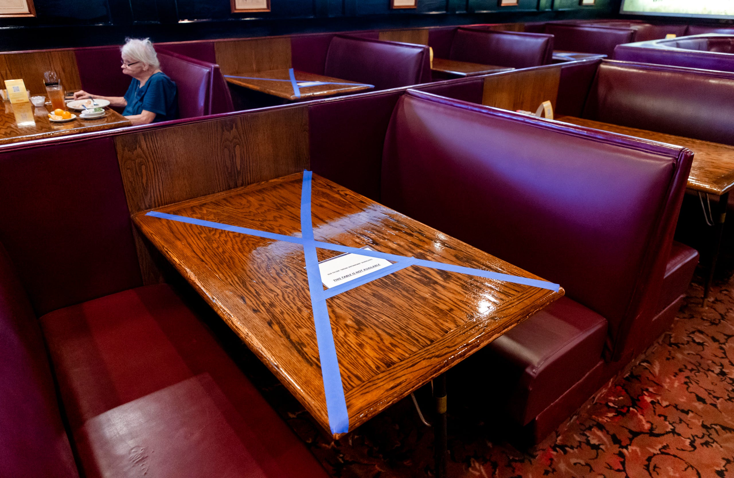 Closed seats to allow for social distancing at Cattlemen's Steakhouse in Oklahoma City, Okla. on Friday, May 1, 2020, as Cattlemen's and other restaurants begin their gradual reopening on Friday after being closed due to the Coronavirus Pandemic.[Chris Landsberger/The Oklahoman]