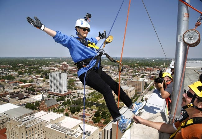 In this 2015 photo, Kelly Dyer Fry, editor of The Oklahoman, prepares to rappel down the former SandRidge Energy Tower in downtown Oklahoma City to bring awareness and to raise funds for Shatterproof, an organization dedicated to ending the stigma of addiction. [Oklahoman archive photo]