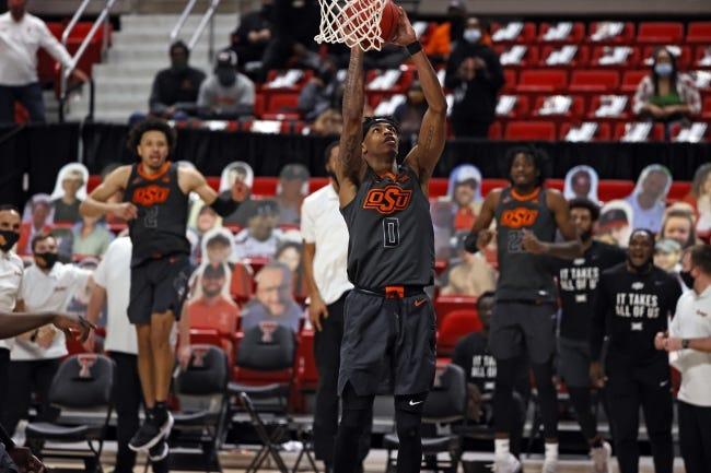Oklahoma State's Avery Anderson III (0) scores the game-winning shot during overtime of an 82-77 Cowboy victory at Texas Tech on Saturday. [AP Photo/Brad Tollefson]