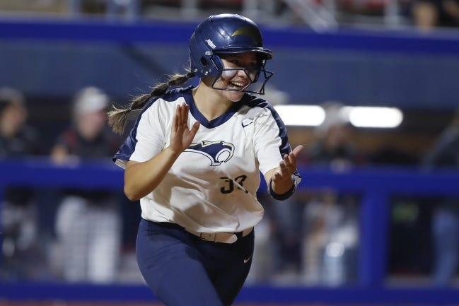 Southmoore's Brinly Maples celebrates after a hit during the Class 6A state softball championship game against Owasso at USA Softball Hall of Fame Stadium on Oct. 17. [Bryan Terry/The Oklahoman]