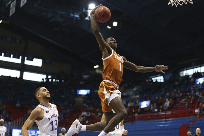 Texas junior guard Andrew Jones looks to dunk against Kansas in the first half in Lawrence, Kan. [Evert Nelson//The Topeka Capital-Journal]