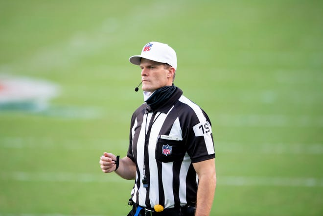 NFL Referee Clay Martin gestures on the field as the Miami Dolphins take on the Kansas City Chiefs during an NFL football game, Sunday, Dec. 13, 2020, in Miami Gardens, Fla. Martin, 45, has been hospitalized while battling COVID-19 at St. Francis Hospital in Tulsa. (AP Photo/Doug Murray)