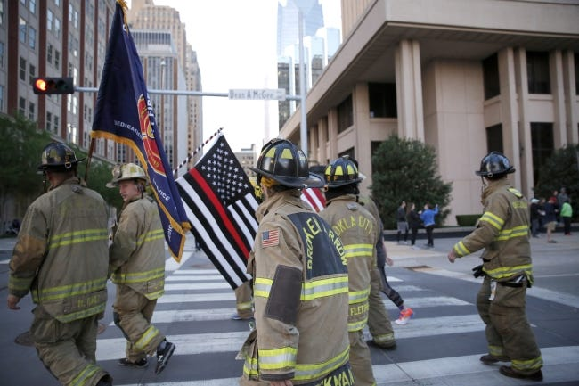 In this 2019 photo, Oklahoma City firefighters in full gear walk during Oklahoma City Memorial Marathon. The Oklahoma City Council this week will consider a measure that will equip some firefighters with body armor. [Sarah Phipps/The Oklahoman]