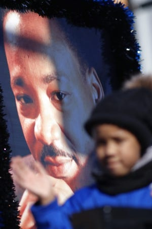 A young girl waves to the crowd from a float with a poster of Martin Luther King Jr. at the 2020 Martin Luther King Holiday Parade in Oklahoma City. The 2021 holiday parade and other activities will be virtual. [Doug Hoke/The Oklahoman]