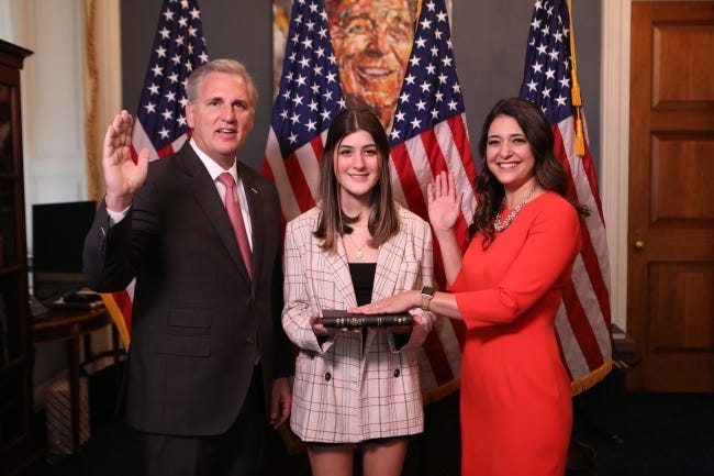 U.S. Rep. Stephanie Bice, right, poses at her mock swearing-in on Sunday, with daughter Ainsley and House Repubican leader Kevin McCarthy, of California.   [House of Representatives Photo]